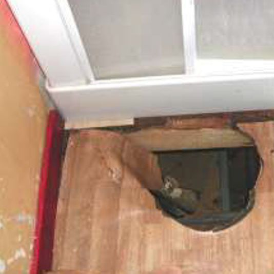 Hole in floor by rotting